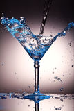 Liquid splash in a martini glass Stock Photo