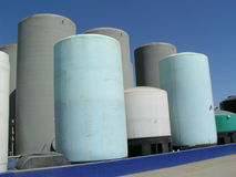 Liquid Storage Tanks. Group of vertical liquid storage tanks Stock Photos