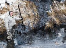 Liquidation noire de pétrole image stock