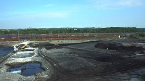 Liquidation of remediation of landfills waste of oil and toxic substances, burnt lime is applied to the oil pollution by