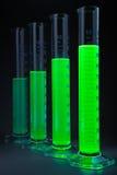 Liquide vert dans des cylindres Photographie stock libre de droits