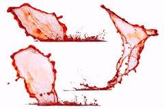 Liquidi spruzzati su un fondo isolato Fotografie Stock Libere da Diritti