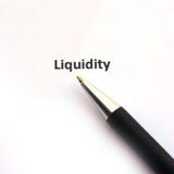 Liquidität mit Stift Stockbild