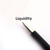 Liquidity with pen. Isolated on white background stock image