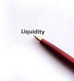 Liquidity with pen. Isolated on white background stock images