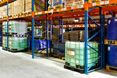 Liquids warehouse. Flammable liquids materials in big industrial warehouse Royalty Free Stock Images