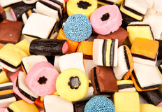 Liquirice allsorts lying on a pile Royalty Free Stock Photo