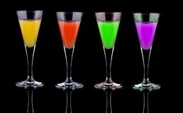 Liquor. A glass with a little of liquor of colors Royalty Free Stock Photo