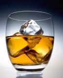 Liquor. Glass on the rocks Stock Photography
