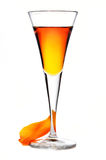 Liquor. Wine-glass of liquor with a tulip petal on a white background Stock Image