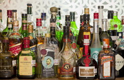 Liquor bottles on a bar Stock Photo