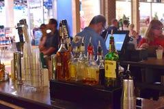Liquor bottles and bartender in outside bar at Lake Buena Vista royalty free stock photos