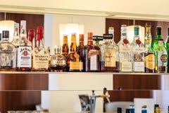 Liquor. Bottles of liquor on shelf in hotel bar Royalty Free Stock Photos