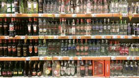 Liquor bottles in supermarket Royalty Free Stock Images