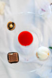 Liquor and candies on a plate Stock Photo