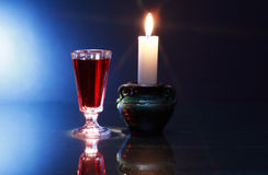 Liquor And Candle Royalty Free Stock Image
