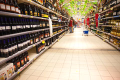 Liquor department  in hypermarket. Large liquor department  in hypermarket. Supermarket in Bucharest - Romania Royalty Free Stock Photo