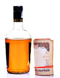 Liquor and money royalty free stock images