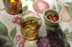 Liquor and pills Stock Photo
