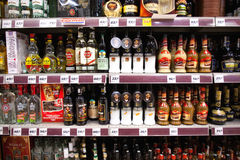 Liquor shelf in store Stock Image