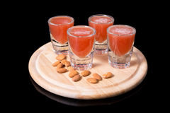Liquor shots with almonds Royalty Free Stock Images