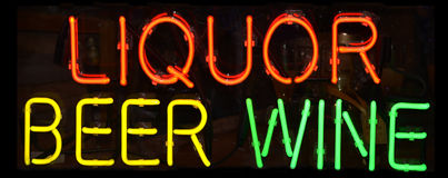 Liquor Sign. A multi colored neon sign reading Liquor Beer Wine Stock Images