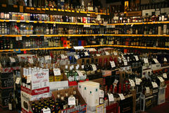 Liquor store. A section of a liquor store with myriad bottles on the shelves Stock Photo
