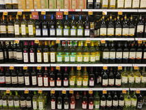 Liquor store. Wine, rum and whiskey display inside a liquor shop Stock Image