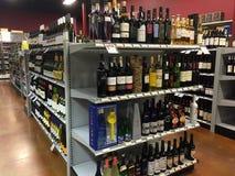 Liquor store. Wine on shelves selling at liquor store, USA Stock Image