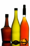 Liquor and wine bottles. Arranged against clear background Stock Photos