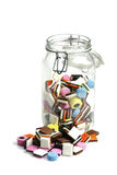 Liquorice all sorts. Glass bottle with colorful liquorice all sorts on a white background Royalty Free Stock Photo