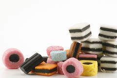 Liquorice allsorts. Stack of colourful candy on a white background Stock Image