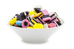 Liquorice allsorts in a bowl Stock Photo