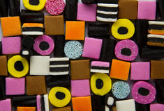Liquorice allsorts fill frame. A shot from above of stacked liquorice allsorts Stock Photography