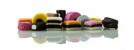 Liquorice allsorts, low reflected Royalty Free Stock Photos