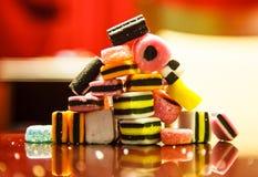 Liquorice allsorts in pyramid. Liquorice allsorts arranged in pyramid shape with reflection Royalty Free Stock Photography