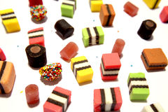 Liquorice allsorts on white Royalty Free Stock Images