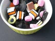 Liquorice candies. In a green bowl Royalty Free Stock Images