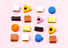 Liquorice candy on a pale pink background Royalty Free Stock Images