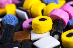 Liquorice candy vibrant background Royalty Free Stock Photos