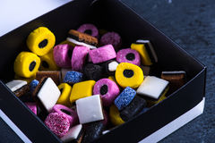 Liquorice candy vibrant background Stock Images