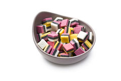 Liquorice confectionery. The sweet liquorice confectionery on white background stock photos