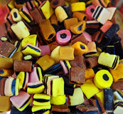 Liquorice multi-color candies. Colorful cubes and cylinders of liquorice candies , a perfect delicious snack for adults and kids Stock Photo