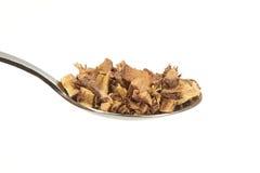 Liquorice root on a teaspoon Royalty Free Stock Photo