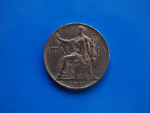 1 lira coin, Kingdom of Italy over blue. 1 lira coin money ITL, currency of Kingdom of Italy over blue background Royalty Free Stock Photo