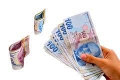 Lira turca llevada a cabo en un fondo blanco Foto de archivo libre de regalías