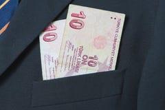 Lira turca nella tasca di un vestito Fotografia Stock