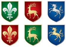 Lirio, ciervo, unicornio, símbolos heráldicos Imagen de archivo libre de regalías