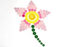 Lirio rosado hecho de los botones de costura Fotografía de archivo