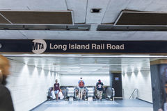 LIRR entrance in Penn Station. New York City, USA - 2 July 2017: Escalators taking passengers to the MTA Long Island Rail Road station from inside Penn Station Royalty Free Stock Images